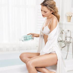 Skin So Soft Original Bath Oil with model